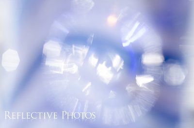 An out of focus reflection creates a bursting effect and beautiful bokeh.